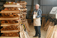 BNPS.co.uk (01202) 558833<br /> Pic: ZacharyCulpin/BNPS<br /> <br /> Tim in the workshop with the cut willow (left) that is ready to be shaped into cricket bats<br /> <br /> Master bat maker Tim Keeley is putting the finishing touches to his beautifully hand-crafted pieces of willow ahead of the forthcoming cricket season.<br /> <br /> Tim, 62, has made almost half a million bats since starting out as an apprentice at Gray Nicholls aged 16 in 1975.<br /> <br /> He is the founder of family business Keeley Cricket, in Battle, East Sussex, which he runs with his brother Nick who has 35 years of bat-making experience.