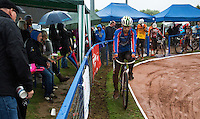31 AUG 2015 - IPSWICH, GBR - Charlie Rumbold of Ipswich rides his bike to the start line along the grass verge in order to keep the tyres clean for a heat during the British Cycle Speedway Championships at Whitton Sports and Community Centre in Ipswich, Suffolk, Great Britain (PHOTO COPYRIGHT © 2015 NIGEL FARROW, ALL RIGHTS RESERVED)