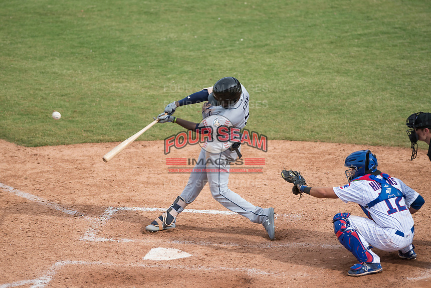 Peoria Javelinas shortstop Lucius Fox (5), of the Tampa Bay Rays organization, hits a home run in front of catcher P.J. Higgins (12) during an Arizona Fall League game against the Mesa Solar Sox on October 11, 2018 at Sloan Park in Mesa, Arizona. The Solar Sox defeated the Javelinas 10-9. (Zachary Lucy/Four Seam Images)