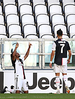 Calcio, Serie A: Juventus - Torino, Turin, Allianz Stadium, July 4, 2020.<br /> Juventus' Juan Cuadrado (l) celebrates after scoring with his teamate Cristiano Ronaldo (r) during the Italian Serie A football match between Juventus and Torino at the Allianz stadium in Turin, July 4, 2020.<br /> UPDATE IMAGES PRESS/Isabella Bonotto