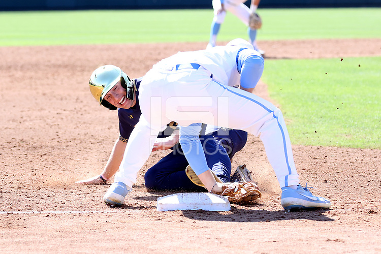 CHAPEL HILL, NC - MARCH 08: Patrick Alvarez #8 of the University of North Carolina tags out Eric Gilgenbach #25 of the University of Notre Dame at third base during a game between Notre Dame and North Carolina at Boshamer Stadium on March 08, 2020 in Chapel Hill, North Carolina.