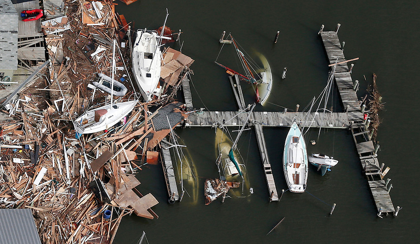 SEA BRIGHT, NJ (11/1/2012) — Aerial view of sunken sailboats and other catastrophic devastation the day after Hurricane Sandy delivered widespread areas of destruction throughout the Jersey Shore.  11/1/12