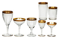 BNPS.co.uk (01202 558833)<br /> Pic: SheldonCarpenter/Witherell'sInc/BNPS<br /> <br /> Pictured: Al and Mae Capone's gold-rimmed crystal stemware.<br /> <br /> An incredible treasure trove of Al Capone heirlooms have sold at auction for a whopping £2.3m. ($3.1m)<br /> <br /> The star lot was the notorious American gangster's favourite gun - a 1911 Colt semi-automatic pistol, which was expected to fetch £110,000 but sold for an incredible £764,000. ($1.04m)<br /> <br /> The remarkable collection, sold by his granddaughters, included personalised jewellery, photographs and furniture and a letter written to his only child Sonny from Alcatraz Prison, which showed a tender side to the ruthless crime boss.