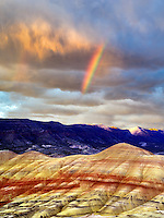 Rainbow and storm clouds. Painted Hills, John Day Fossil Beds National Monument, Oregon
