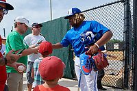 Dunedin Blue Jays Vladimir Guerrero Jr. (27) signs autographs after a Florida State League game against the Clearwater Threshers on April 7, 2019 at Jack Russell Memorial Stadium in Clearwater, Florida.  Dunedin defeated Clearwater 2-1.  (Mike Janes/Four Seam Images)
