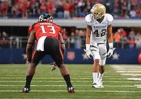 Baylor inside receiver LEVI NORWOOD (42) and Texas Tech University linebacker SAM EGUAVOEN (13) during NCAA Football game at Cowboys Stadium in Arlington, Texas. Baylor defeats Texas Tech 52-45 in over time..