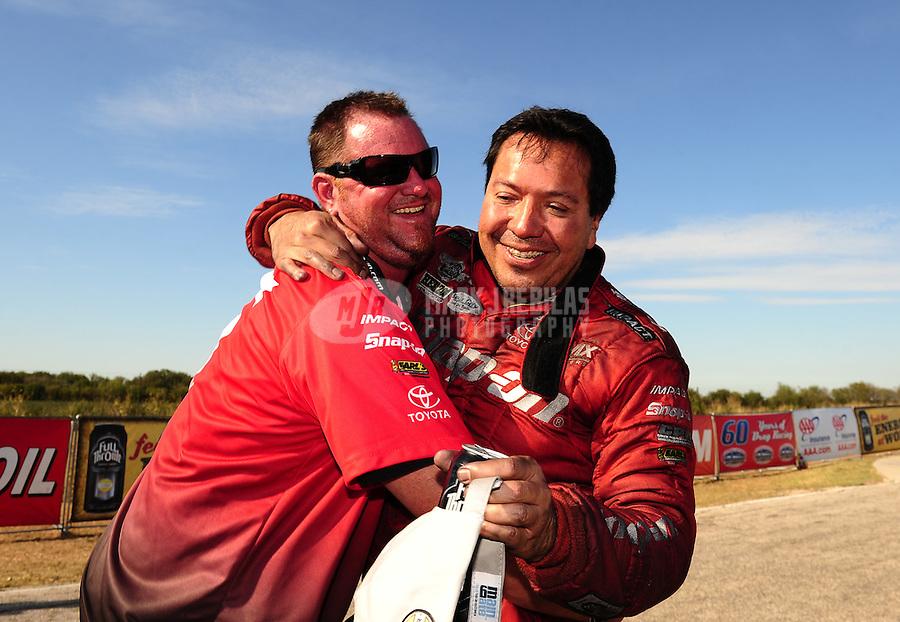 Sept. 25, 2011; Ennis, TX, USA: NHRA funny car driver Cruz Pedregon celebrates with his crew after winning the Fall Nationals at the Texas Motorplex. Mandatory Credit: Mark J. Rebilas-