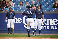 Wilmington Blue Rocks Chris DeVito (right) high fives Anderson Miller (24) after a home run during the second game of a doubleheader against the Frederick Keys on May 14, 2017 at Daniel S. Frawley Stadium in Wilmington, Delaware.  Wilmington defeated Frederick 3-1.  (Mike Janes/Four Seam Images)