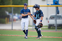 GCL Rays pitcher Justin Montgomery (19) and catcher Dawson Dimon (14) celebrate after closing out a Gulf Coast League game against the GCL Pirates on August 7, 2019 at Charlotte Sports Park in Port Charlotte, Florida.  GCL Rays defeated the GCL Pirates 5-3 in the second game of a doubleheader.  (Mike Janes/Four Seam Images)