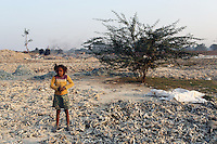 A child worker stands amongst leather trimmings discarded from local tanneries. The waste is laced with toxins produced in the tanning process. The city is notorious for having some of the country's worst pollution which is created by the local leathery tannery industry.