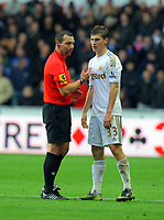 Saturday, 03 November 2012<br /> Pictured: Ben Davies of Swansea (R) is spoken to by match referee K Friend<br /> Re: Barclays Premier League, Swansea City FC v Chelsea at the Liberty Stadium, south Wales.