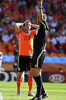 Rafael Van der Vaart of Holland stands dejected as the referee gives a decision against his team