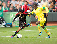 San Francisco, California - Saturday March 17, 2012: Javier Aquino and Saliou Ciss in action during the Mexico vs Senegal U23 in final Olympic qualifying tuneup. Mexico defeated Senegal 2-1