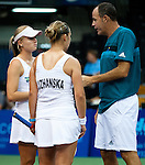 Chanel Simmonds and Tetiana Luzhanska consult with coach Brent Haygarth during the Freedoms vs. Explorers WTT match in Villanova, PA on July 16, 2012
