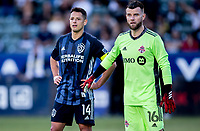 """CARSON, CA - FEBRUARY 15: Javier """"Chicharito"""" Hernandez #14 of the Los Angeles Galaxy and Quentin Westberg #16 of Toronto FC during a game between Toronto FC and Los Angeles Galaxy at Dignity Health Sports Park on February 15, 2020 in Carson, California."""