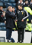 Ally McCoist cracking jokes with fourth official Kevin Clancy after Rangers take the lead