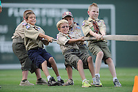 Boy Scouts participate in a tug-of-war between innings of a game between the Kannapolis Intimidators iand the Greenville Drive on Monday, August 5, 2013, at Fluor Field at the West End in Greenville, South Carolina. (Tom Priddy/Four Seam Images)