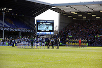 Pictured: Everton and Swansea players during a minute's applause for Sir Tom Finney before kick off. Sunday 16 February 2014<br /> Re: FA Cup, Everton v Swansea City FC at Goodison Park, Liverpool, UK.