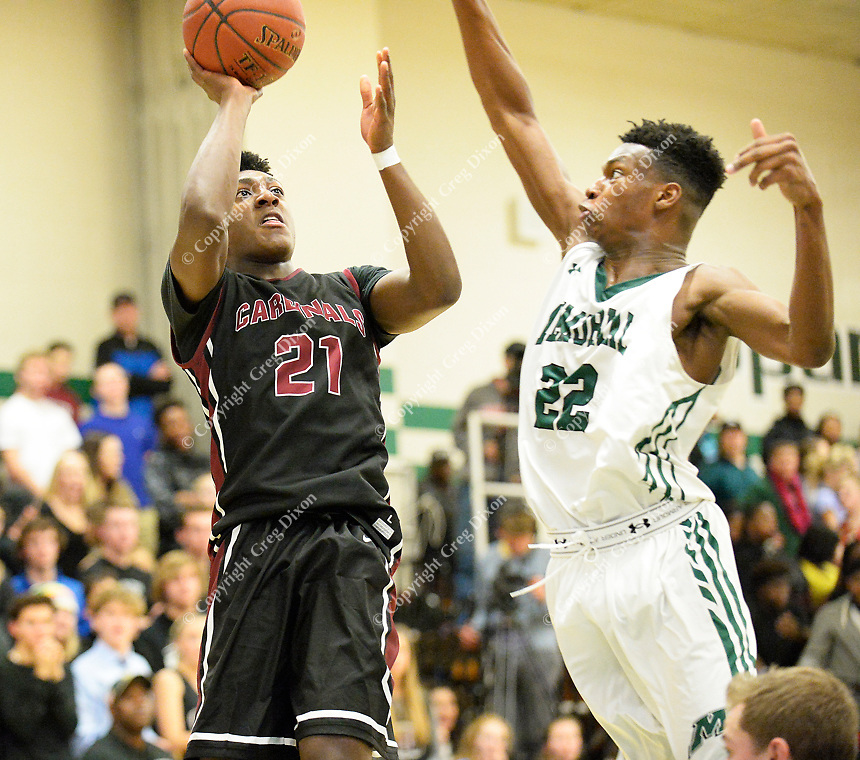 Middleton's Tyree Eady tries to shoot past the block of Memorial's Chris Knight during the second half of the Big Eight Conference boys basketball game between Middleton and Madison Memorial on Thursday at Memorial High School in Madison