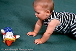 7 month old baby boy crawling toward toy horizontal Caucasian