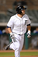 Mesa Solar Sox outfielder Tyler Collins (4), of the Detroit Tigers organization, jogs to first watching his teams third home run of the inning during an Arizona Fall League game against the Peoria Javelinas on October 17, 2013 at HoHoKam Park in Mesa, Arizona.  Mesa defeated Peoria 6-1.  (Mike Janes/Four Seam Images)