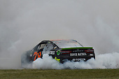 Monster Energy NASCAR Cup Series<br /> Tales of the Turtles 400<br /> Chicagoland Speedway, Joliet, IL USA<br /> Sunday 17 September 2017<br /> Martin Truex Jr, Furniture Row Racing, Furniture Row/Denver Mattress Toyota Camry celebrates his win with a burnout<br /> World Copyright: Logan Whitton<br /> LAT Images