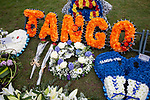 © Joel Goodman - 07973 332324 . 17/03/2012 . Staffordshire , UK . A floral tribute with PC Rathband's callsign - Tango 190 - left at the graveside . The funeral of former police officer David Rathband , at Stafford Crematorium . Rathband was found dead at his home in Blyth on 29th February 2012 . He was shot and blinded by killer Raoul Moat whilst he was on duty in the early hours of 4th July 2010 and went on to campaign for the Blue Lamp Foundation , which supports emergency staff injured in the line of duty , but he was reported to have never overcome the psychological impact of his injuries . Photo credit : Joel Goodman