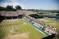1-7-08, England, Wimbledon, Tennis, Court 18 foreground court 19 and court 1 to the right and Aorangi Park with Henman Hill in the back
