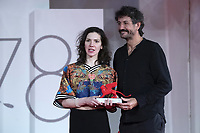 """Director George Chiper Lillemark and Monica Stan receive the Lion of the Future – Luigi De Laurentiis Award For A Debut Film for """"Imaculat"""" during the Winners Red Carpet as part of the 78th Venice International Film Festival in Venice, Italy on September 11, 2021. <br /> CAP/MPI/IS/PAC<br /> ©PAP/IS/MPI/Capital Pictures"""