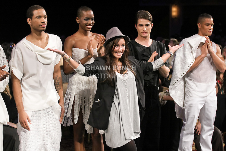 Fashion designer Kristin Zimmermann, walks with models at the close of her 3zehn Fall 2011 fashion show, during Couture Fashion Week Fall 2011 in New York.