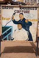 Senegal, Touba.  Barber Shop Sign.
