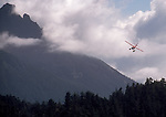Alaska, A float plane banks for a landing on the west coast of Chichagof Island, West Chichagof-Yakobi Wilderness, Southeast Alaska, USA, plane: DeHavilland Otter, .