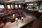 """© Joel Goodman - 07973 332324 . 14/03/2014 . White Horse Pub , Gilda Brook Road , Eccles M30 0DX , UK . Interior GV General View of the pub . Landlady Bernadette """" Babs """" Harvieu (52 , correct) is unable to renew her contract with Robinsons brewery . Photo credit : Joel Goodman"""