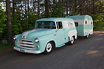 Two-toned sea foam green and antique white 1955 Dodge C-3 Town Panel vehicle towing a 1954 Zollinger VA-KA-SHUN-ETTE vintage travel trailer canned ham (same two-toned color).