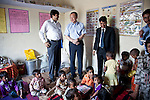 12 March 2013, Kanpur, Uttar Pradesh India: President of the World Bank, Mr Jim Yong Kim speaks with children on his visit to the village of Tilsarikhurd village near to the city of Kanpur in Uttar Pradesh state. Mr.Kim is visiting India  for meetings with local staff, Indian Government Ministers and to inspect projects sponsored by World Bank in regional areas. Picture by Graham Crouch/World Bank