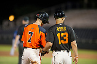 AZL Giants manager Hector Borg (13) congratulates second baseman Kyle McPherson (7) after a triple against the AZL Rangers on August 22 at Scottsdale Stadium in Scottsdale, Arizona. AZL Rangers defeated the AZL Giants 7-5. (Zachary Lucy/Four Seam Images via AP Images)
