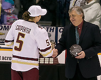 North Andover, Massachusetts - March 6, 2016: NCAA Division I, Women's Hockey East final. Boston College (white/maroon) defeated Boston University (red), 5-0, at Lawler Arena at Merrimack College. Boston College has a perfect Hockey East season - regular season, Bean Pot winner, and Women's Hockey East winner. Women's Hockey East tournament most valuable player, unanimous vote, awarded to Alex Carpenter.