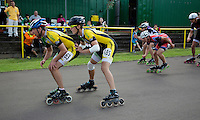 11 AUG 2013 - BIRMINGHAM, GBR - Ben Coole-Probert  (left) of Birmingham Wheels Roller Speed Club is propelled forward at the changeover by team mate Michal Roman (right) during the Junior and Senior Men's 3000m Relay at the Federation of Inline Speed Skating 2013 British Outdoor Championships at Birmingham Wheels Park in Birmingham, West Midlands, Great Britain (PHOTO COPYRIGHT © 2013 NIGEL FARROW, ALL RIGHTS RESERVED)
