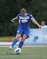 Boston Breakers defender Cat Whitehill (4) takes a shot. In a National Women's Soccer League (NWSL) match, Boston Breakers (blue) tied Western New York Flash (white), 2-2, at Dilboy Stadium on August 3, 2013.