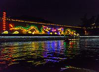 Nanjing, Jiangsu, China. Night Cruise on the Qinhuai River, Illuminated Dragons Opposite Confucian Temple Area.