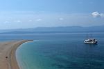 .Brac Island. Bol. Beach of Zlatni Rat (gold Cape).Cruise in Croatia. Island of Dalmatia