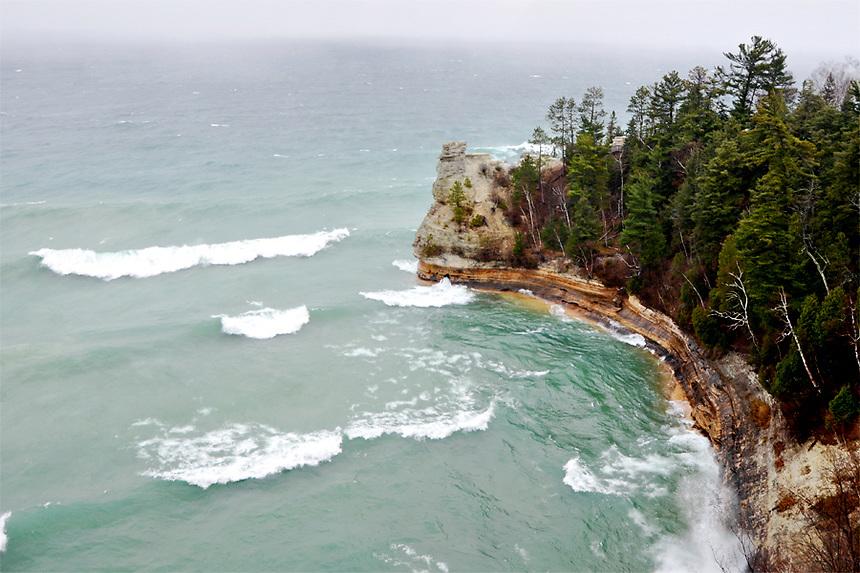 Large waves crashing into the shoreline at Miners Castle. Munising, MI - Pictured Rocks National Lakeshore