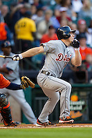 Detroit Tigers outfielder Andy Dirks (12) follows through on his swing during the MLB baseball game against the Houston Astros on May 3, 2013 at Minute Maid Park in Houston, Texas. Detroit defeated Houston 4-3. (Andrew Woolley/Four Seam Images).