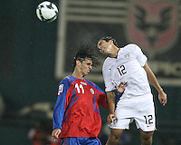 Jonathan Bornstein #12 of the USA wins a header from Bryan Ruiz #11 of Costa Rica during a 2010 World Cup qualifying match in the CONCACAF region at RFK Stadium on October 14 2009, in Washington D.C.The match ended in a 2-2 tie.