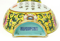 BNPS.co.uk (01202 558833)<br /> Pic: Sworders/BNPS<br /> <br /> The vital Qianlong stamp - that shows the vase was made for the Emperor and not for export.<br /> <br /> A humble Chinese vase bought for just £1 in a charity shop in Hertfordshire has sold for a staggering £484,000 yesterday - after research revealed it was made for 18th century Chinese Emperor Qianlong.<br /> <br /> At first the lucky shopper, unaware of its significance, listed the small yellow vase on eBay - only to be inundated with messages and bids.<br /> <br /> Realising it must be valuable, he removed it from the site and took it to specialists at Sworders Fine Art Auctioneers' in Stansted Mountfitchet, Essex.<br /> <br /> They studied the 8ins tall vase and identified it as being Chinese imperial and made for the Qianlong Emperor, who reigned from 1735 to 1796.<br /> <br /> The vase sparked a bidding war, with the successful Chinese buyer paying six times the auction house's pre-sale estimate of £80,000.
