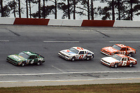 HAMPTON, GA - NOV 3:  Joe Ruttman(4), Ron Bouchard (47), Eddie Bierschwale (6) and Neil Bonnett (12) race through a turn during the Atlanta Journal 500 NASCAR Winston Cup race at Atlanta Motor Speedway, November 3, 1985. (Photo by Brian Cleary/www.bcpix.com)