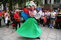 A woman protesting for equal marriage in Northern Ireland joins thousands of people in this year's Pride Parade in the centre of Cardiff, Wales, UK. Sayurday 26 August 2017