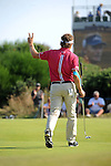 Current leader Bernhard Langer walks away from the 13th green during day one of The Senior Open Golf Tournament at The Royal Porthcawl Golf Club in South Wales this afternoon.