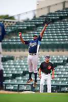 GCL Rays first baseman Devin Davis (32) jumps for a throw during the second game of a doubleheader against the GCL Orioles on August 1, 2015 at the Ed Smith Stadium in Sarasota, Florida.  GCL Orioles defeated the GCL Rays 11-4.  (Mike Janes/Four Seam Images)