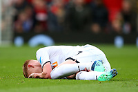 Sam Clucas of Swansea City lies injured on the pitch during the Premier League match between Manchester United and Swansea City at the Old Trafford, Manchester, England, UK. Saturday 31 March 2018